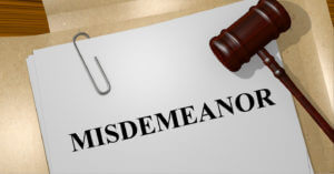 misdemeanor charges on a paper with gavel